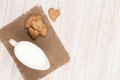 Heart shaped gingerbread cookies and milk pitcher Royalty Free Stock Photos
