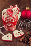 Heart shaped gingerbread cookies on red cup with christmas decor Royalty Free Stock Photos