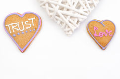 Heart shaped gingerbread with text and gray/white background. Valentines day symbol Stock Photos