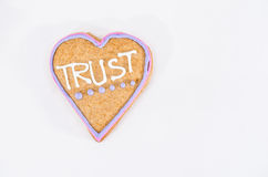 Heart shaped gingerbread with text and gray/white background. Valentines day symbol Royalty Free Stock Image