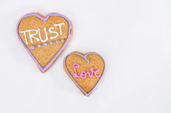 Heart shaped gingerbread with text and gray/white background. Valentines day symbol Stock Photo