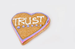 Heart shaped gingerbread with text and gray/white background. Valentines day symbol Royalty Free Stock Photo