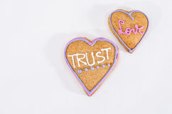 Heart shaped gingerbread with text and gray/white background. Valentines day symbol Royalty Free Stock Photography