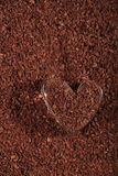 Heart shaped glass with grated dark chocolate Royalty Free Stock Photos