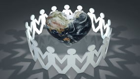 Heart shaped globe surrounded by white silhouette people cut outs stock footage