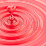Heart shaped glossy liquid drop Stock Image