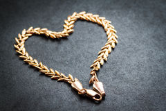 Heart shaped gold chain. Royalty Free Stock Image
