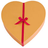 Heart shaped golden chocolate box with ribbon Royalty Free Stock Photo