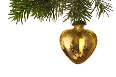 Heart Shaped Golden Christmas Bauble hanging from a twig Royalty Free Stock Photos