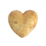 Heart shaped golden potato spud Stock Images