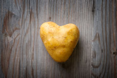 Heart shaped golden potato Royalty Free Stock Photo