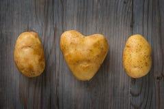 Heart shaped golden potatoes stock image