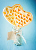 Heart shaped golden waffles Stock Photos