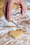 The heart-shaped gouge V4. Heart shape is gouged in the dough by hand Royalty Free Stock Image