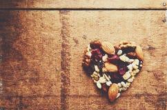 Heart shaped granola with wholegrain cereals, nuts and raisin Royalty Free Stock Photo