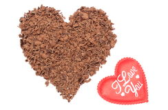 Heart shaped grated chocolate on white background Royalty Free Stock Photos