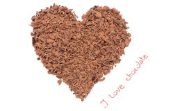 Heart shaped grated chocolate on white background Stock Photo