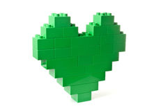 Heart shaped green building blocks. Yellow building blocks shaped as a heart over white background royalty free stock photography