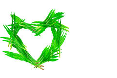 Heart shaped green grass on white background Royalty Free Stock Photos