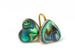 Heart-shaped green paua pearl shell  earrings.  Royalty Free Stock Images