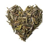 Heart shaped from green tea isolated on white background. stock photos