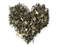 Heart shaped from green tea with jasmine isolated on white background. Royalty Free Stock Image