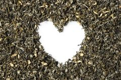 Heart shaped from green tea with jasmine on white background Royalty Free Stock Photos