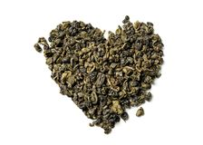 Heart shaped of green tea on white background. royalty free stock photo