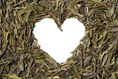 Heart shaped from green tea on white background. Stock Images