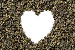 Heart shaped of green tea on white background stock photos