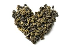 Heart shaped of green tea on white background. stock image