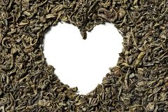 Heart shaped of green tea on white background royalty free stock photos