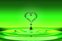 Heart shaped green water drops Stock Photo