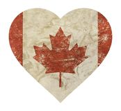 Heart shaped grunge vintage faded flag of Canada. Heart shaped old grunge vintage dirty faded shabby distressed Canadian Canada flag with red maple leaf isolated Royalty Free Stock Image
