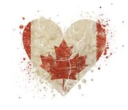Heart shaped grunge vintage faded flag of Canada. Heart shaped old grunge vintage dirty faded shabby distressed Canadian Canada flag with red maple leaf and bang stock photo