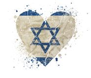 Heart shaped grunge vintage faded flag of Israel. Heart shaped old grunge vintage dirty faded shabby distressed Israel flag with blue Star of Judah Magen David royalty free stock photo