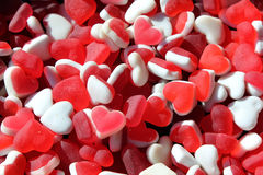 Heart shaped gum candies background. Love and valentines day concept stock image