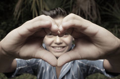 Heart shaped hand Stock Image