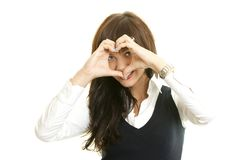Heart shaped by the hands of a beautiful young wom Stock Photography