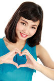 Heart shaped by the hands of a beautiful young women Royalty Free Stock Images