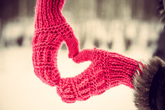 Heart shaped hands in the gloves outdoor royalty free stock images