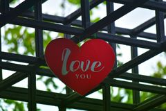 Heart-shaped hanging sign In the backyard Is a red heart royalty free stock images