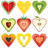 Heart Shaped Healthy Fruit Halves Collection. Nine heart shaped fruits cut in half including watermelon, orange, kiwi, avocado, strawberry, apple, papaya Royalty Free Stock Images