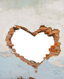 Heart shaped hole. In old brick wall Royalty Free Stock Images