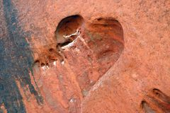 Heart shaped hole in rock. At famous Uluru, a world heritage landscape in outback Australia. Ayers Rock. Northern Territory, Australia Stock Image