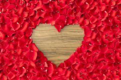 Heart shaped hole in rose petals - love and valentine background Stock Photo