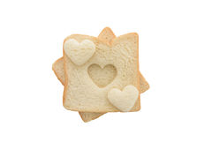 Heart shaped hole in a slice of bread isolated Stock Photo