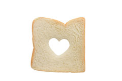 Heart shaped hole in a slice of bread isolated Stock Photography