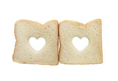 Heart shaped hole in a slice of bread isolated Royalty Free Stock Images