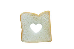 Heart shaped hole in a slice of bread isolated Royalty Free Stock Photo